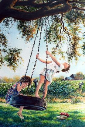 Children playing in the garden on a swing